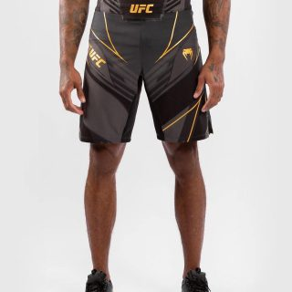 """Venum UFC Authentic Fight Nighy Long Fir Shorts Black Gold. 🔥 - Use """"INSTA5"""" for 5% off your purchase at www.minotaurfightstore.co.uk! The best Boxing, Muay Thai, MMA, BJJ & No Gi gear at the best prices. - 🇬🇧 FREE UK Shipping 🌍 Worldwide Shipping Available!"""